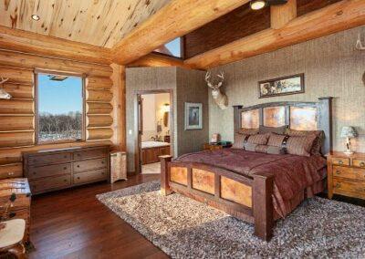 Log Home Bedroom Open Ceiling