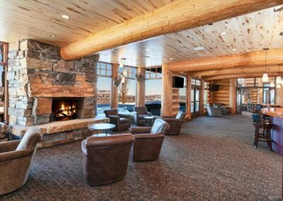 Log Home Entertainment Room With Stone Fireplace