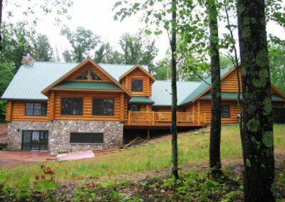 Two Story Log Cabin Woods